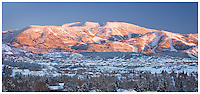 Alpenglow and a recent snowfall combine to create a scene at once dramatic and tranquil in Steamboat springs, CO.
