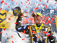 Sep 5, 2016; Clermont, IN, USA; Confetti falls as NHRA top fuel driver Tony Schumacher celebrates after winning the US Nationals at Lucas Oil Raceway. Mandatory Credit: Mark J. Rebilas-USA TODAY Sports