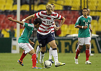 MEXICO CITY, MEXICO - AUGUST 15, 2012:  Brek Shea (11) of the USA MNT is tackled by Severo Meza (5) of  Mexico during an international friendly match at Azteca Stadium, in Mexico City, Mexico on August 15. USA won 1-0.