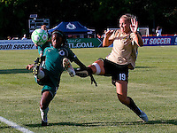Saint Louis Athletica forward Enoila Aluko (9) and FC Gold Pride defender Carrie Dew (19) during a WPS match at Anheuser-Busch Soccer Park, in St. Louis, MO, July 26, 2009.  The match ended in a 1-1 tie.