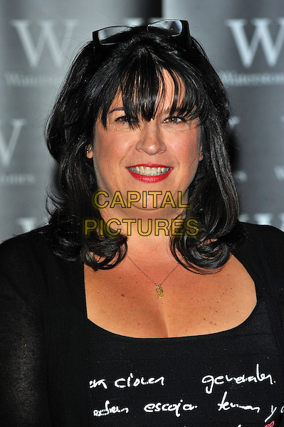 E. L. James signs copies of her book 'Fifty Shades of Grey' at Waterstones, Piccadilly, London, England..September 6th, 2012.headshot portrait black top red lipstick  .CAP/CJ.©Chris Joseph/Capital Pictures.