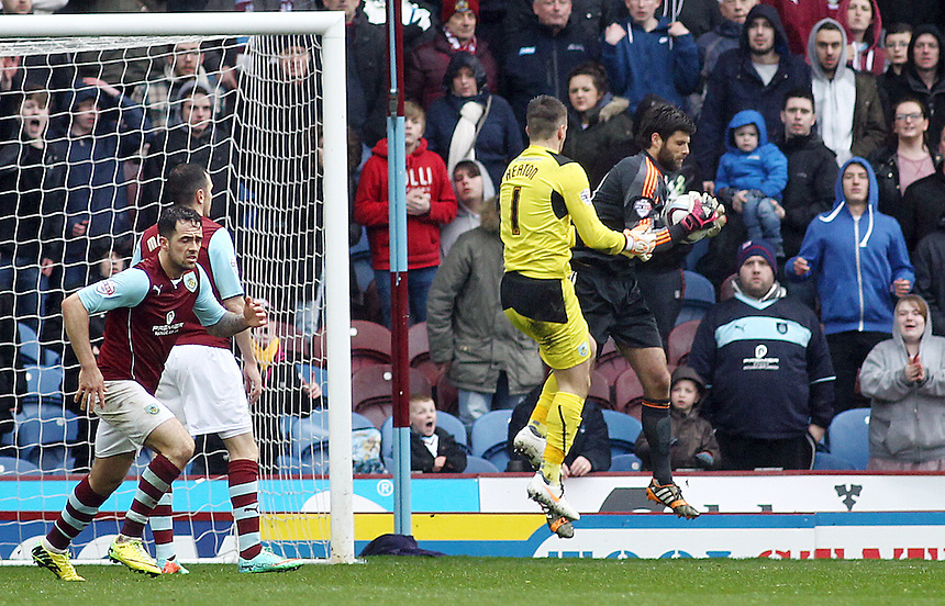Middlesbrough's Dimitrios Konstantopoulos claims an aerial ball despite the attentions of Burnley goal-keeper Tom Heaton who pushed forward in the dying minutes as his side desperately tried to equalise<br /> <br /> Photo by Rich Linley/CameraSport<br /> <br /> Football - The Football League Sky Bet Championship - Burnley v Middlesbrough - Saturday 12th April 2014 - Turf Moor - Burnley<br /> <br /> &copy; CameraSport - 43 Linden Ave. Countesthorpe. Leicester. England. LE8 5PG - Tel: +44 (0) 116 277 4147 - admin@camerasport.com - www.camerasport.com
