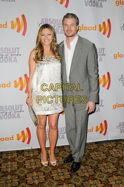 REBECCA GAYHEART & ERIC DANE.arriving at the 21st Annual GLAAD Media Awards at the Hyatt Century Plaza Hotel in Century City, California, USA, April 17th, 2010..arrivals full length dress silver beige patterned pattern print shiny sleeveless peep toe cream shoes clutch bag married couple husband wife grey gray suit white shirt .CAP/ROT.©Lee Roth/Capital Pictures