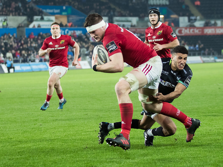 Munster's Jack O'Donoghue scores his sides first try<br /> <br /> Photographer Simon King/CameraSport<br /> <br /> Guinness PRO12 Round 15 - Ospreys v Munster - Saturday 18th February 2017 - Liberty Stadium - Swansea<br /> <br /> World Copyright &copy; 2017 CameraSport. All rights reserved. 43 Linden Ave. Countesthorpe. Leicester. England. LE8 5PG - Tel: +44 (0) 116 277 4147 - admin@camerasport.com - www.camerasport.com