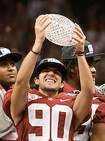 Jeremy Shelley of Alabama holds up National Championship trophy after defeating LSU during BCS National Championship game at Mercedes-Benz Superdome in New Orleans, Louisiana on January 9th, 2012.   Alabama defeated LSU, 21-0.