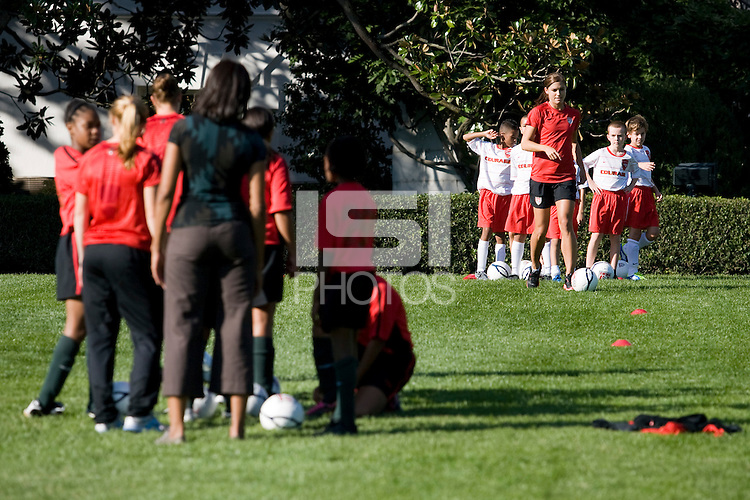 Alex Morgan. Michelle Obama hosted a Lets Move! soccer clinic held on the South Lawn of the White House assisted by members of the USWNT.  Let's Move! was started by Mrs. Obama as a way to promote a healthier lifestyle in children across the country.