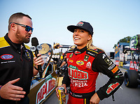 Aug 18, 2017; Brainerd, MN, USA; NHRA top fuel driver Leah Pritchett (right) is interviewed by announcer Brian Lohnes during qualifying for the Lucas Oil Nationals at Brainerd International Raceway. Mandatory Credit: Mark J. Rebilas-USA TODAY Sports