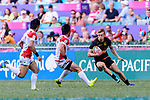 Tim Lichtenberg of Germany (R) runs with the ball during the HSBC World Rugby Sevens Series Qualifier Final match between Germany and Japan as part of the HSBC Hong Kong Sevens 2018 on 08 April 2018 in Hong Kong, Hong Kong. Photo by Marcio Rodrigo Machado / Power Sport Images