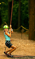 High-adventure participants practice climbing and repelling at the US National Whitewater Center (USNWC). The USNWC's facilities offer multiple high-adventure outdoor sports, including ropes courses, zip line courses, rafting, canoeing, kayaking, hiking, biking, running and more. The center opened to the public in 2006.