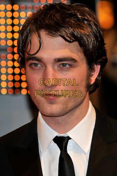 ROBERT PATTINSON.Arrivals at the Orange British Academy Film Awards 2010 at the Royal Opera House, Covent Garden, London, England, UK, .21st February 2010.BAFTA BAFTAs portrait headshot greasy hair  black tie white shirt .CAP/PL.©Phil Loftus/Capital Pictures