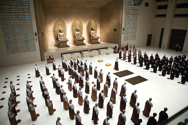 Buddhist monks pray and meditate at the Dharma Drum Mountain monastry. Sanjie Village, Jinshan, Taipei County, Taiwan , R.O.C. Asia