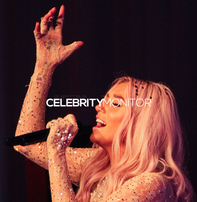 SANTA MONICA, CA, USA - JUNE 11: Kesha, Ke$ha at the Pathway To The Cures For Breast Cancer: A Fundraiser Benefiting Susan G. Komen held at the Barker Hangar on June 11, 2014 in Santa Monica, California, United States. (Photo by Xavier Collin/Celebrity Monitor)