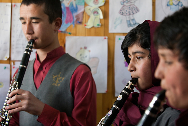18 May 2012, Kabul Afghanistan: Clarinet  students from left Abdul Satar Ali (13), Nilofar Hamidi (12) and Omar Sarwadi (11) practise during a lesson at the National Institute of Music. Dr Ahmad Nasir Sarmast founded the Afghanistan National Institute of Music in Kabul that takes in students from all walks of Afghan life to educate them in musical studies. The World Bank is supporting this legacy by providing funding for a new concert hall and to gather additional land to expand the premises. Many of the students are orphans who would otherwise have no opportunity or access to the knowledge or instruments that the Institute has gathered. Up to half a dozen ex-patriate music  teachers run classes in music that ranges from traditional Afghan and classical  music to modern rock.  Picture by Graham Crouch/World Bank