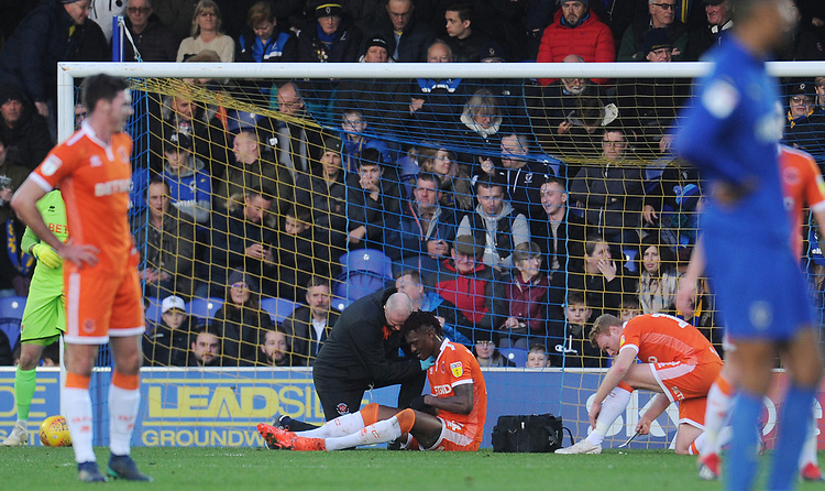 Blackpool's Armand Gnanduillet receives treatment for an injury<br /> <br /> Photographer Kevin Barnes/CameraSport<br /> <br /> The EFL Sky Bet League One - AFC Wimbledon v Blackpool - Saturday 29th December 2018 - Kingsmeadow Stadium - London<br /> <br /> World Copyright © 2018 CameraSport. All rights reserved. 43 Linden Ave. Countesthorpe. Leicester. England. LE8 5PG - Tel: +44 (0) 116 277 4147 - admin@camerasport.com - www.camerasport.com