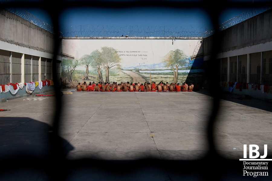 Prisoners are given time during the day to sunbathe in a courtyard at Floramar Prison in Divinopolis, Brasil. Prisoners are required to sit during this period. Some chant, sing to themselves or talk with the guards but are on the whole much quieter than the inmates at the adolescent jail next door. IBJ Fellow Dr. Saliba is hoping to inform these prisoners of their right to habeas corpus which would protect them from illegal internment