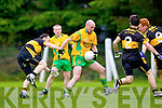 Timmy O'Leary of Dr Crokes tries to hold back Mike S Murphy of Gneeveguilla in Gneeveguilla last Sunday evening in round 1 of the Garvey's Supervalue County Senior Championship.