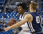 Nevada guard Jazz Johnson drives past Colorado Christian guard      Collin Huun (10) during the first half of an NCAA college basketball game in Reno, Nev., Wednesday, Oct. 30, 2019. .