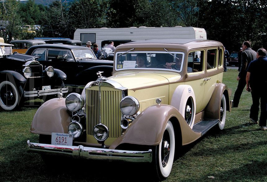 A yellow and tan 1934 Packard at a classic-antique auto meet. nostalgia, luxury, collecting, automobiles, vintage, cars. Vermont.