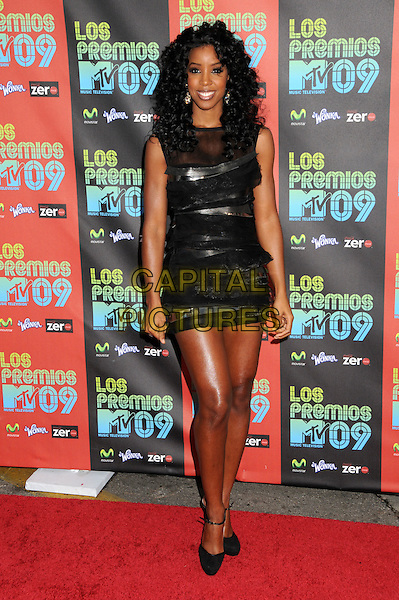 KELLY ROWLAND .MTV Los Premios Awards 2009 held at the Gibson Amphitheatre, Universal City, California, USA, 15th October 2009..full length black dress sleeveless ruffles layered layers ankle strap silver mini sheer mesh see through.CAP/ADM/BP.©Byron Purvis/Admedia/Capital Pictures