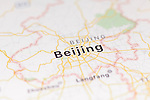 Closeup of Beijing city map on the screen of a GPS device, Apple iPhone maps app