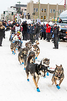 Paige Drobny and team leave the ceremonial start line with an Iditarider and handler at 4th Avenue and D street in downtown Anchorage, Alaska on Saturday March 7th during the 2020 Iditarod race. Photo copyright by Cathy Hart Photography.com