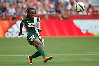 June 16, 2015: Sarah NNODIM of Nigeria kicks the ball during a Group D match at the FIFA Women's World Cup Canada 2015 between Nigeria and the USA at BC Place Stadium on 16 June 2015 in Vancouver, Canada. USA won 1-0. Sydney Low/Asteriskimages.com