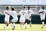Wake's Steven Curfman (l) celebrates scoring the game's first goal at 37:47 with teammates Julian Valentin (4), Sam Cronin (2), Michael Lahoud (13), and Marcellus Tennyson (23) on Tuesday, November 8th, 2005 at SAS Stadium in Cary, North Carolina. The Wake Forest Demon Deacons defeated the Boston College Eagles 4-0 during their Atlantic Coast Conference Tournament Play-In game.