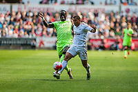 ( L-R ) Bacary Sagna of Manchester City  and `s2m` in action during the Barclays Premier League match between Swansea City and Manchester City played at the Liberty Stadium, Swansea on the 15th of May  2016