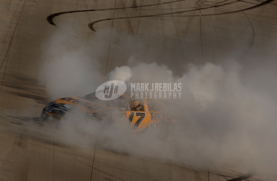 June 4, 2006; Dover, DE, USA; Nascar Nextel Cup driver Matt Kenseth (17) celebrates after winning the Neighborhood Excellence 400 at Dover International Speedway. Mandatory Credit: Mark J. Rebilas