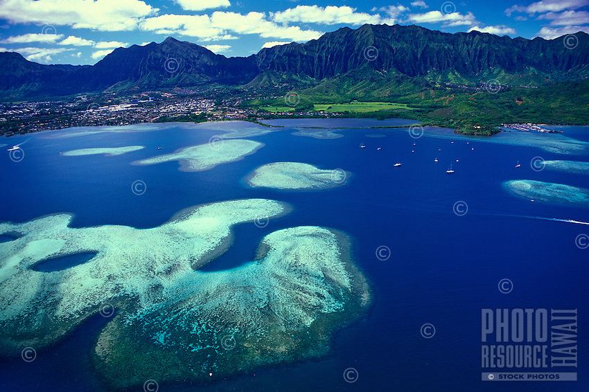 Aerial view of Kaneohe Bay and it's many table reefs and sand bars. Located along oahu's windward coast. A very popular area for many ocean related activities including snorkeling, boating, fishing, and sailing.