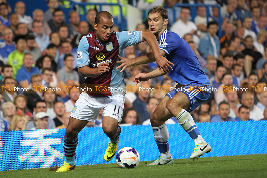 Gabriel Agbonlahor of Aston Villa powers past Branislav Ivanovic of Chelsea - Chelsea vs Aston Villa - Barclays Premier League Football at Stamford Bridge, Fulham Road, London - 21/08/13 - MANDATORY CREDIT: Simon Roe/TGSPHOTO - Self billing applies where appropriate - 0845 094 6026 - contact@tgsphoto.co.uk - NO UNPAID USE