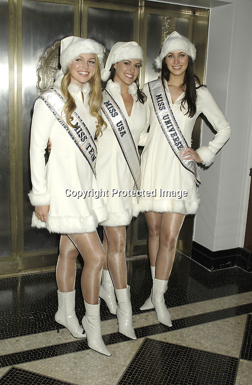Miss Teen USA, Allie LaForce,  Miss USA Chelsea Cooley  Miss Universe Natalie Glebova ..at The Hulaween Ball Celebrating  Bette Midler's 10th Anniversary of The New York Restoration Project and Bette Midler's 60th Birthday on October 31, 2005 at The Waldorf Astoria Hotel. ..Photo by Robin Platzer, Twin Images