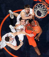 Syracuse forward Rakeem Christmas (25) is surrounded by Virginia guard Joe Harris (12), Virginia guard London Perrantes (23) and Virginia forward/center Mike Tobey (10) during an NCAA basketball game Saturday March 1, 2014 in Charlottesville, VA. Virginia defeated Syracuse 75-56.