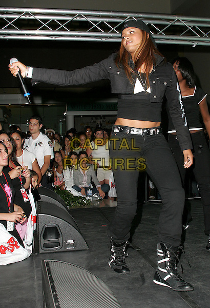 CIARA.Performs live during Teen People's Rock -n- Shop Mall Tour held at The Laguna Hills Mall in Laguna Hills, California,.Friday August 13 2004..full length singer concert live music black cap hat .Ref: DVS.www.capitalpictures.com.sales@capitalpictures.com.©Capital Pictures.