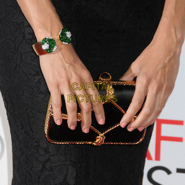 Eva Mendes' bag.AFI FEST 2012 'Holy Motors' special screening, Grauman's Chinese Theatre, Hollywood, California, USA..3rd November 2012.hands gold red green bracelet clutch black lace   .CAP/ADM/BP.©Byron Purvis/AdMedia/Capital Pictures.