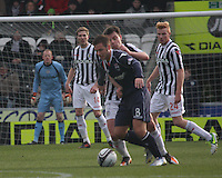 Paul Lawson coming under pressure from Paul McGowan in the St Mirren v Ross County Clydesdale Bank Scottish Premier League match played at St Mirren Park, Paisley on 19.1.13.