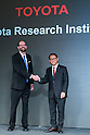 (L to R) Toyota's Executive Technical Advisor Dr. Gill Pratt and Akio Toyoda  President of Toyota Motor Corporation shake hands during a news conference on November 6, 2015, Tokyo, Japan. President Toyoda announced that Toyota would start a new company Toyota Research Institute (TRI) in Silicon Valley, USA, which will focus on Artificial Intelligence and robotics. Dr. Gill will be the Chief Executive Officer of the new company which will begin operations in January 2016. (Photo by Rodrigo Reyes Marin/AFLO)