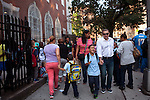 Yokayra Fernandez-Haghighi with her husband Saeid Haghighi, walk their children Jesus Haghighi, 7, and Victoria Haghighi, 12, (hidden behind her mother) to school in Fordham Heights, The Bronx, NY on September 11, 2013.