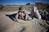 A picture dated August 18 2011 shows a woman cleaning her quinoa in the region of Lake Titicaca, in La Paz, Bolivia.  2013  was declared the international year of Quinoa by the UN.  Bolivia is the main producer of quinoa in the world.