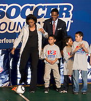 First Lady Michelle Obama kicks off a drill during a US Soccer Foundation clinic held at City Center in Washington, DC.