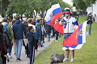 MOSCOW, RUSSIA - June 14, 2018: A vendor sells Russia flags outside the Moscow FIFA Fan Fest at Moscow State University during the opening match of the 2018 FIFA World Cup.