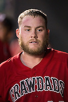 Chuck Moorman (29) of the Hickory Crawdads returns to the dugout after hitting a home run against the Charleston RiverDogs at L.P. Frans Stadium on August 25, 2015 in Hickory, North Carolina.  The Crawdads defeated the RiverDogs 7-4.  (Brian Westerholt/Four Seam Images)