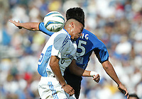 24 October 2004:  Jose Burciaga, Jr. of Wizards battles the ball in the air with Brian Ching of Earthquakes at Spartan Stadium in San Jose, California.   Earthquakes defeated Wizards, 2-0.  Credit: Michael Pimentel / ISI