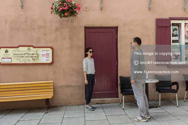 "Tourists take a photo in front of a door in the Quebec city neighborhood of Petit Champlain in Quebec city Monday July 10, 2017. The ""red magic door"" plays a major roles in the episode 2 of the popular Korean TV show Goblin: The Lonely and great God and has become a popular sightseeing within the asian tourist."