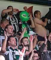 Plymouth Argyle supporters celebrate victory with a Green Alien inflatable during the Sky Bet League 2 match between Wycombe Wanderers and Plymouth Argyle at Adams Park, High Wycombe, England on 12 September 2015. Photo by Andy Rowland.