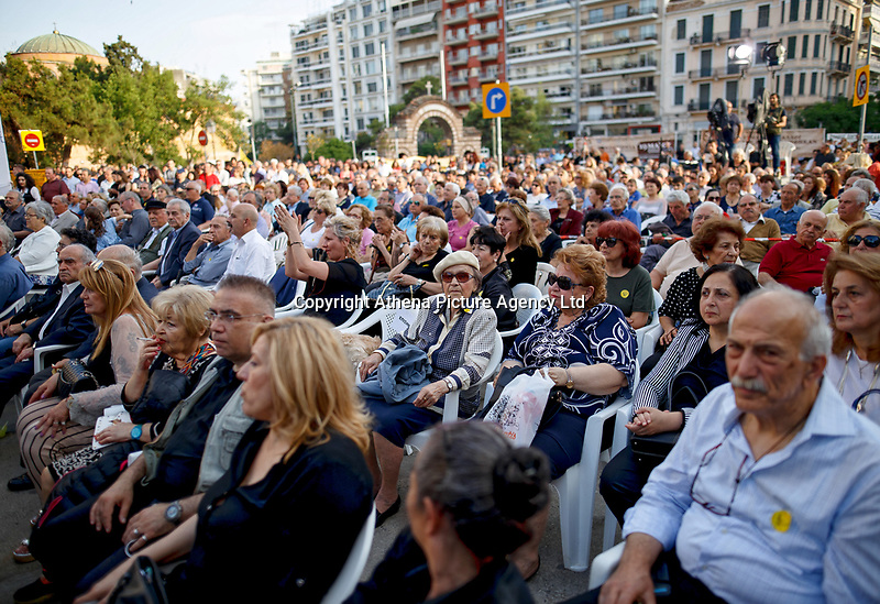 Pictured: The commemoration under way in Thessaloniki, northern Greece. <br /> Re: Thessaloniki's mayor, Yiannis Boutaris, has been attacked during an event commemorating the first world war massacre of Black Sea Greeks by Turks.<br /> He was rushed to hospital with head, back and leg injuries. <br /> Footage from the scene shows the mayor being heckled before the assailants hurled bottles at him and kicked him in the head and legs. As he is escorted into his car, some of the attackers attempt to smash the vehicle's windows.<br /> Police have arrested two people.