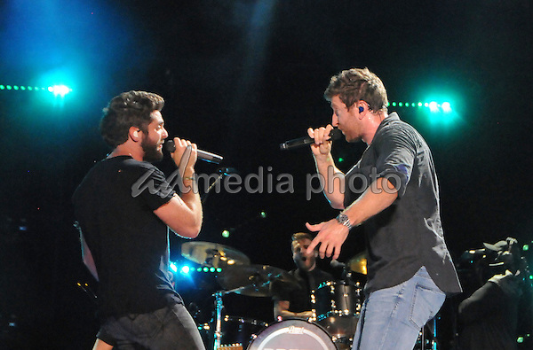 12 June 2016 - Nashville, Tennessee - Thomas Rhett, Brett Eldredge. 2016 CMA Music Festival Nightly Concert held at Nissan Stadium. Photo Credit: Dara-Michelle Farr/AdMedia