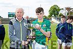 St Brendans College  captain Eoghan O'Sullivan receives the Russell cup from Christy Killeen after they defeated Mercy Mounthawk in the final at Fitzgerald Stadium on Friday