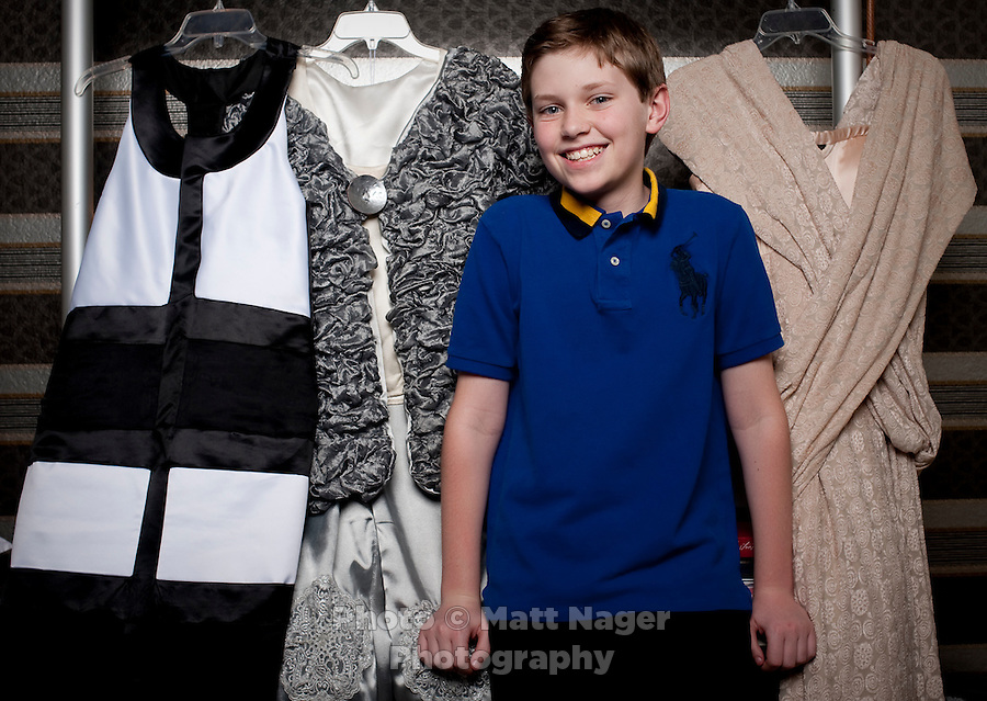 Grant Mower (cq, age 12), already an award winning fashion designer stands in front of three of his designs at his home in Flower Mound, Texas, Friday, February 18, 2011. Grants mother, Moanna Mower (cq) constructs his designs, which Grant sketches. ..Photo by Matt Nager