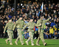 Soldiers from the Yorkshire Regiment march off the field after a minute's silence for their six fallen comrades in Afghanistan before the LV= Cup semi final match between Bath Rugby and Leicester Tigers at The Recreation Ground, Bath (Photo by Rob Munro, Fotosports International)